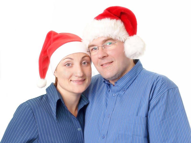 Jeunes couples dans des chapeaux de Santa photos libres de droits