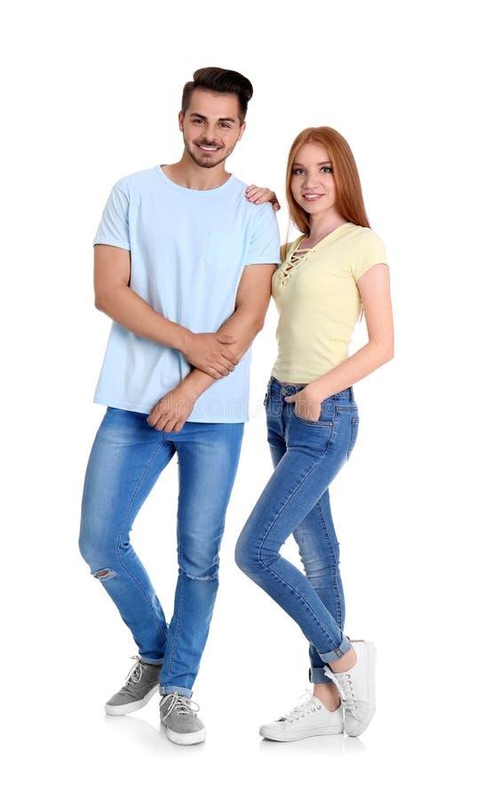 Jeunes couples dans des jeans élégants images stock