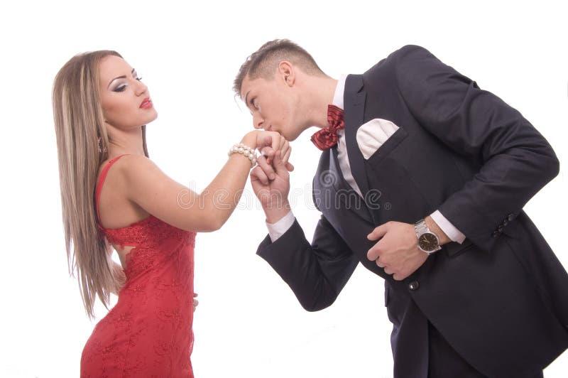 Jeunes couples réussis sur le backgound blanc photographie stock