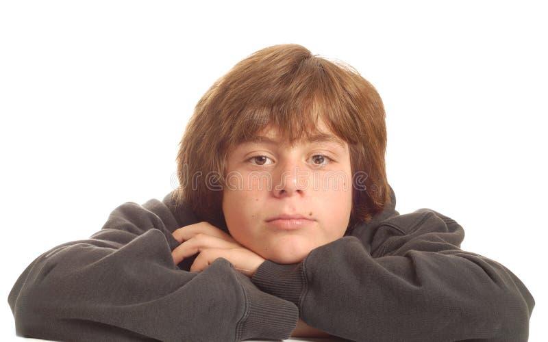 jeunes d'adolescent ennuyés de garçon photo libre de droits