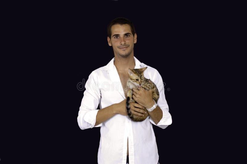 jeunes d'animal familier d'homme de chat photographie stock