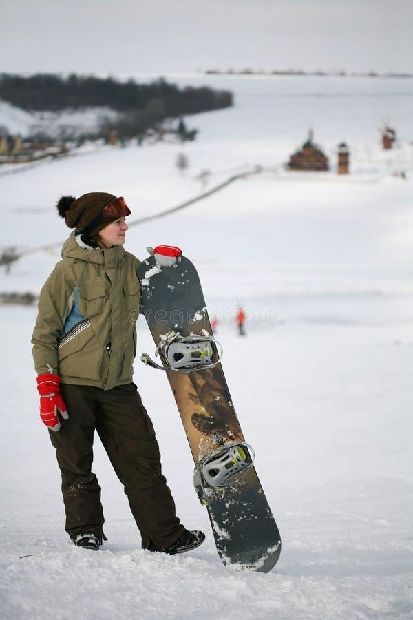 jeunes de snowboarder de femelle adulte images libres de droits