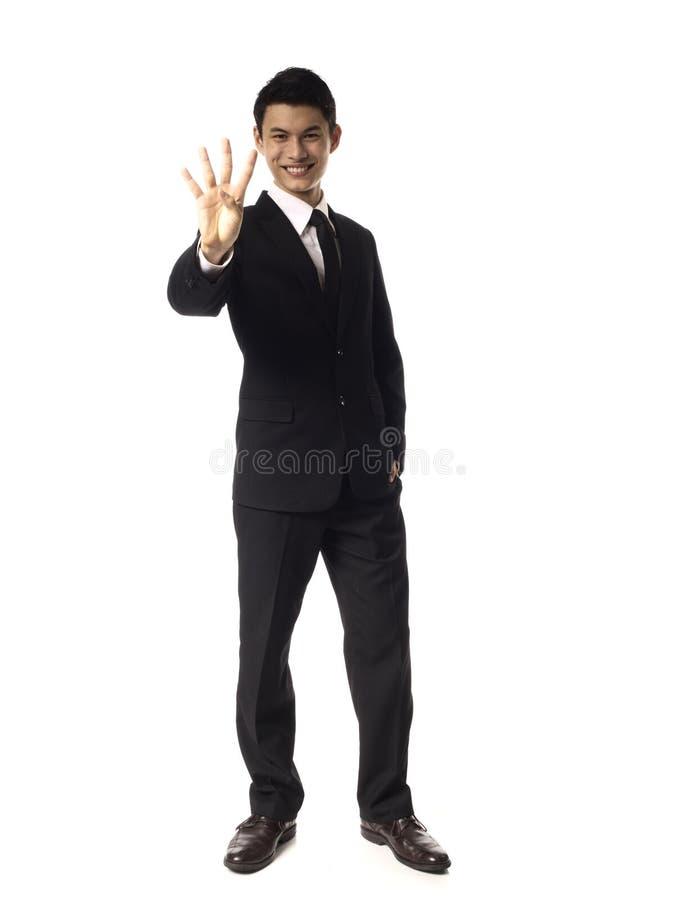 Jeunes doigts de corporation asiatiques de l'homme quatre photographie stock