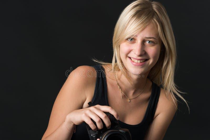 Jeunes femmes avec l'appareil-photo photographie stock libre de droits