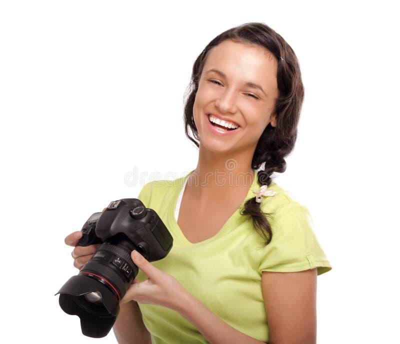 Jeunes femmes avec l'appareil-photo D'isolement sur le blanc photo libre de droits