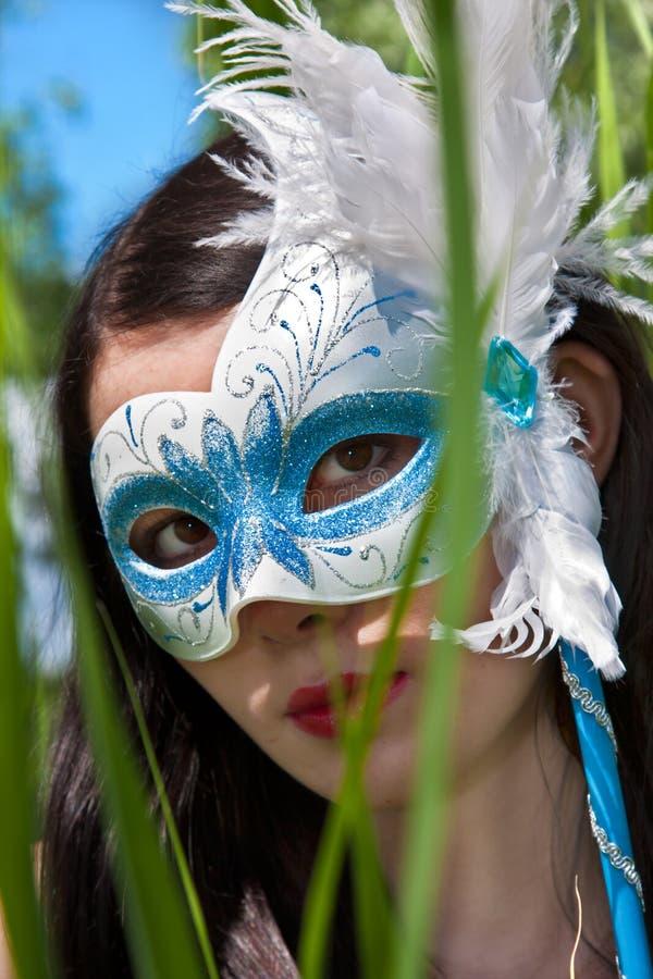 Jeunes femmes dans le masque photo libre de droits