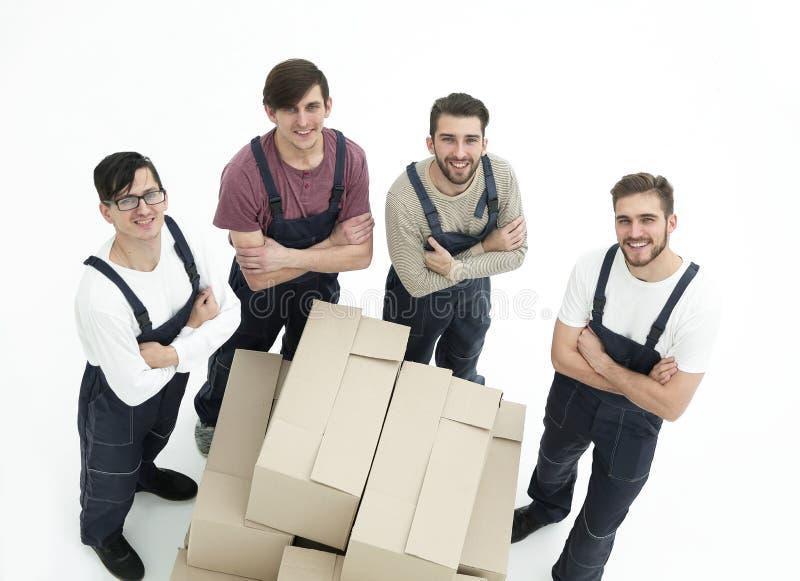Jeunes moteurs jugeant des boîtes d'isolement sur le fond blanc, photos libres de droits