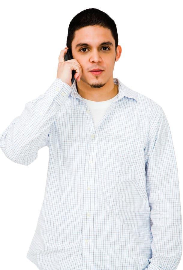 jeunes parlants de téléphone d'homme images libres de droits
