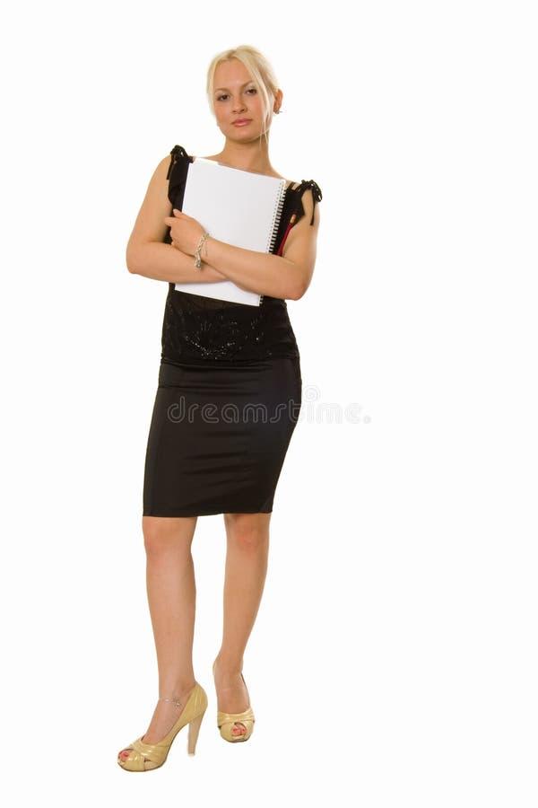 Jeunes position et fixation blondes de femme un cahier images libres de droits