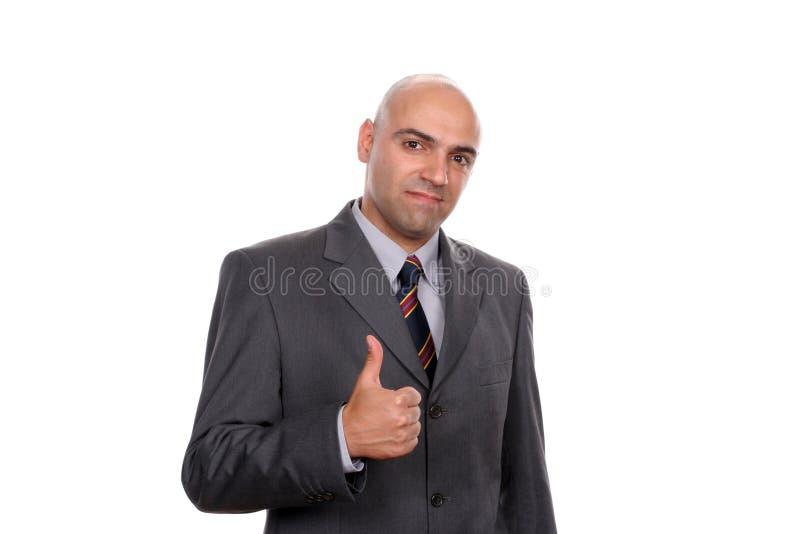 Jeunes pouces allants d'homme d'affaires vers le haut image stock