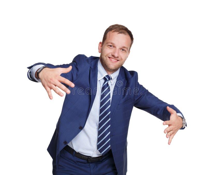 Jeunes prises heureuses d'homme d'affaires quelque chose d'isolement sur le blanc photographie stock libre de droits