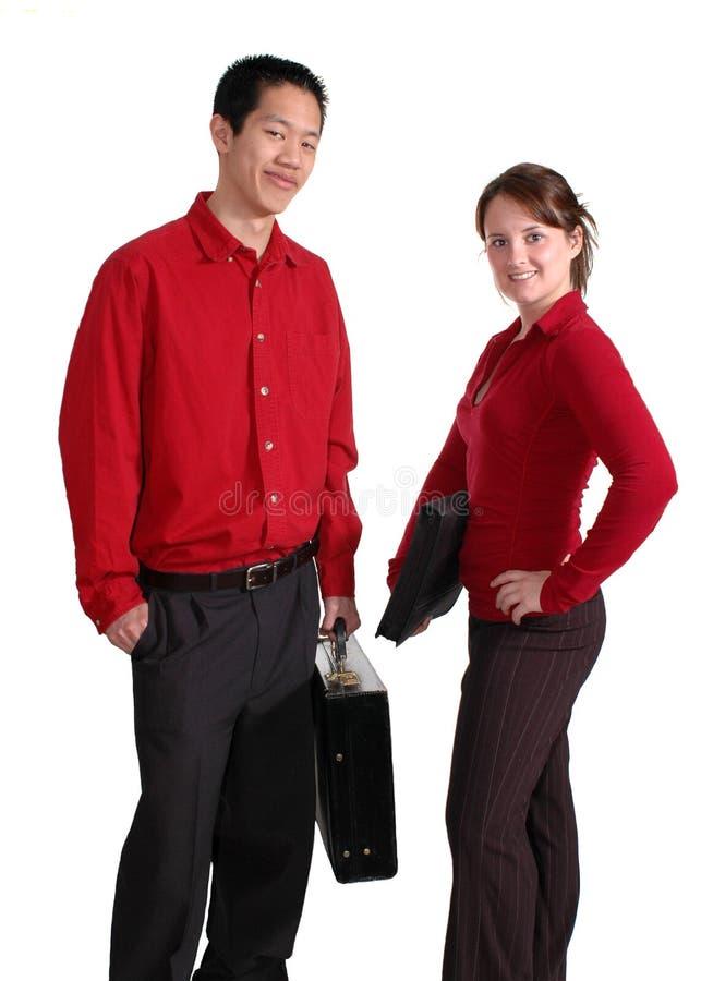 Jeunes professionnels en rouge photographie stock