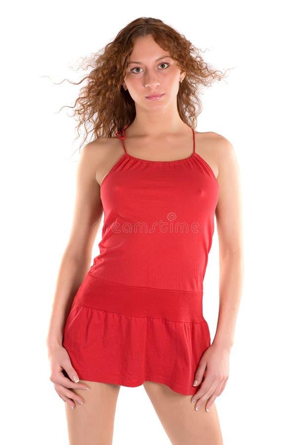 jeunes rouges de femme de robe photo stock