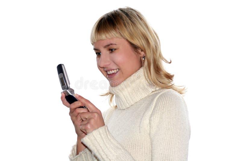 Jeunes sms blonds de femme image libre de droits