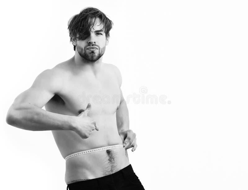 Jeunes utilisations sexy caucasiennes de macho mesurant la bande photos libres de droits