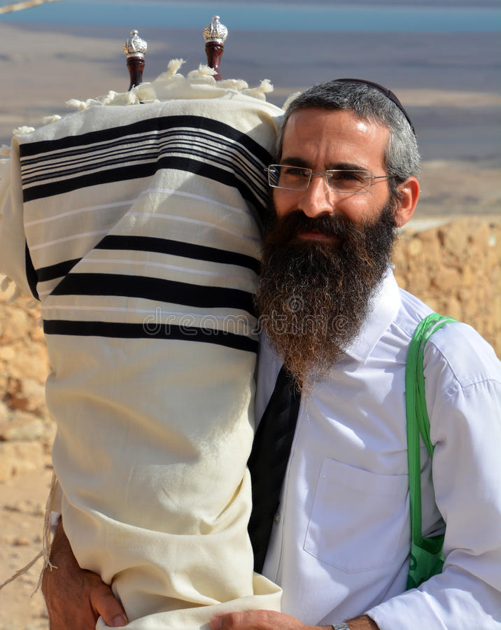 Rabbi. MASADA ISRAEL 04 11 16: Jews come to the desert fortress of Masada from every corner of the globe to celebrate the seminal rite of passage of their sons royalty free stock photo