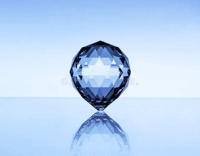Jewel. A shining jewel on bright blue background royalty free stock photo