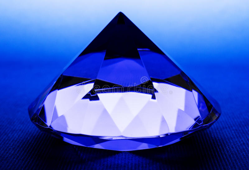 Jewel. On blue background closeup stock image