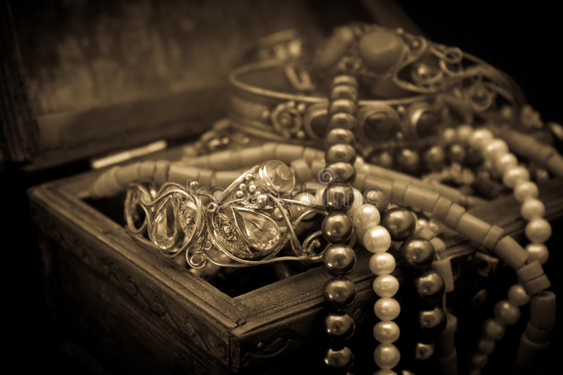 Jewel box. Sepia image of the jewel box full of jewels stock image