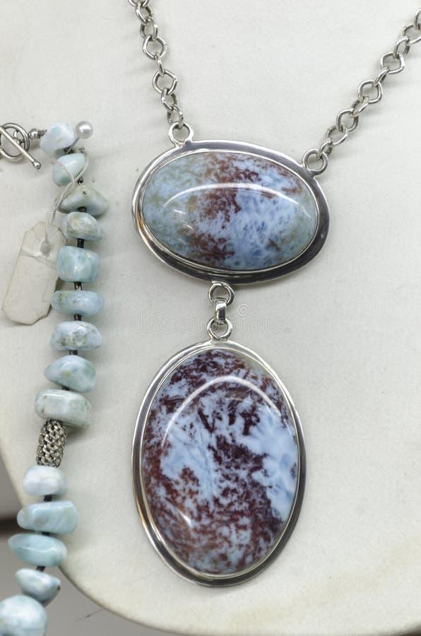 Jewel carved in pristine precious larimar royalty free stock photo