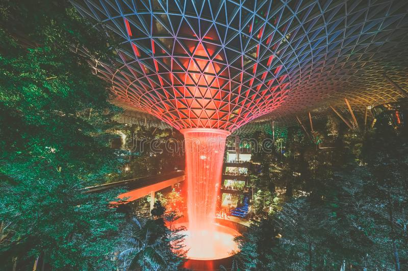 Jewel Changi Airport, Singapore - July 30th 2019 : Jewel Changi Airport Rain Vortex. The largest indoor waterfall in the world . V stock photography