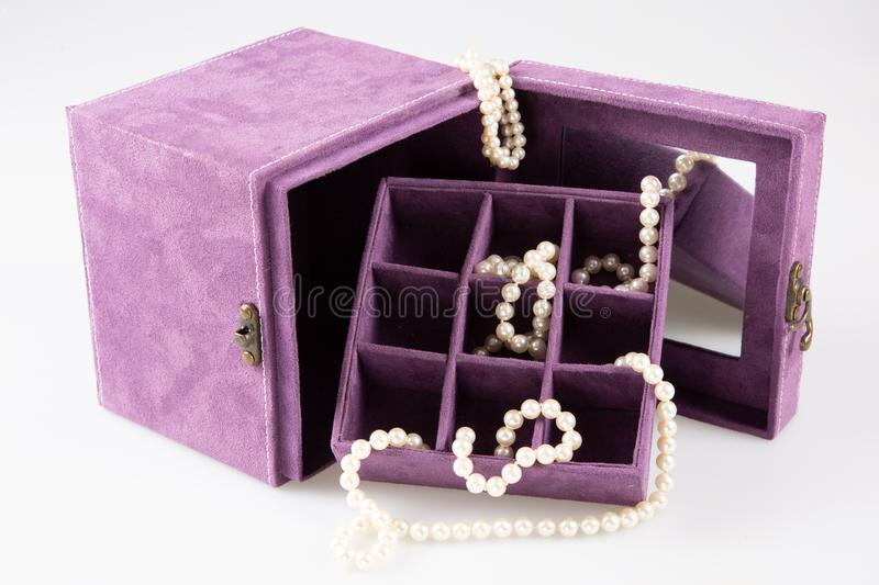 Jewel pink box with white pearl necklace bracelet. A jewel pink box with white pearl necklace bracelet royalty free stock photo