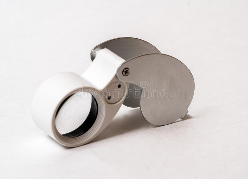Magnifying glass. Magnifying lens that the jewelers use when appraising fine gems and jewelry royalty free stock photos