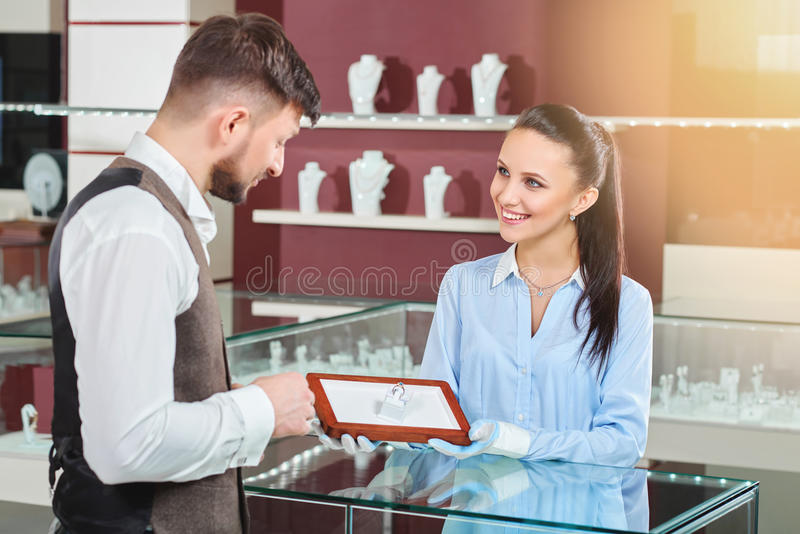 Jeweler showing for man engagement ring with blue stone. stock images