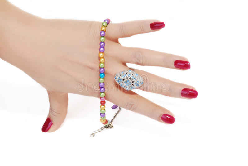 Jewelery in der Hand lizenzfreie stockbilder