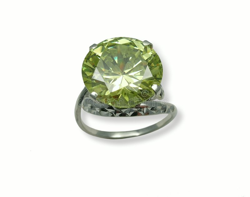 Jeweller ring. With chrysolite. Isolated on white stock image