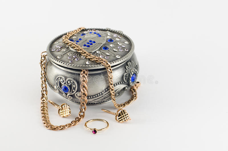 Jewellery box with gold jewelry royalty free stock photo