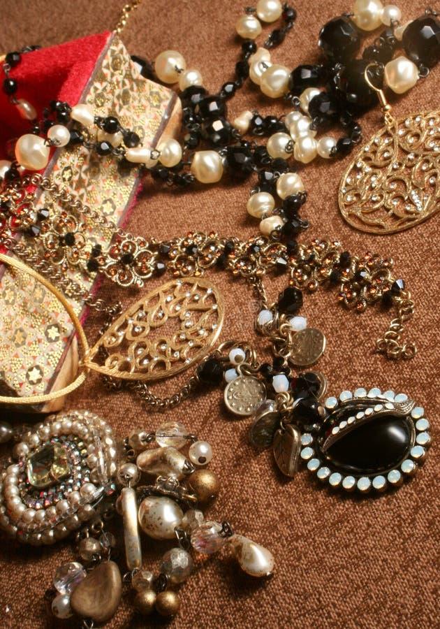 Jewelry. Overflowing jewelry box stock photo