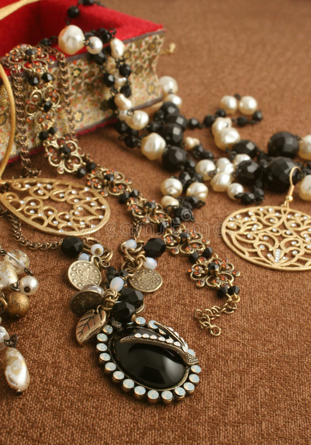 Jewelry. Overflowing jewelry box royalty free stock images