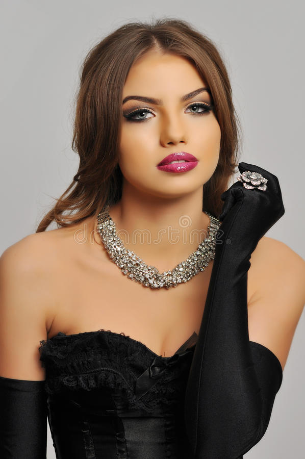 JEWELRY. BEAUTY STUDIO SHOT WITH JEWELRY AND PERFECT MAKE-UP stock image