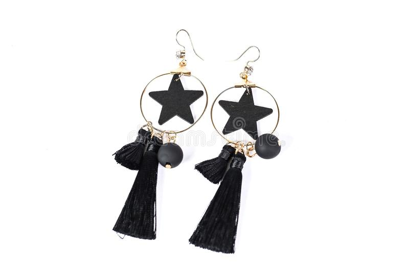 Jewelry. Black earrings add elegance to women who wear them royalty free stock photography