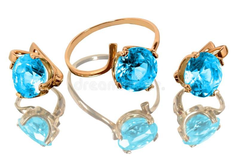Jewelry with blue topaz royalty free stock photos