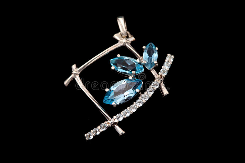 Jewelry with blue topaz and brilliants stock image