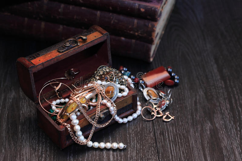 Jewelry Box. Nice vintage open box full of various jewelry on dark wooden background royalty free stock photography