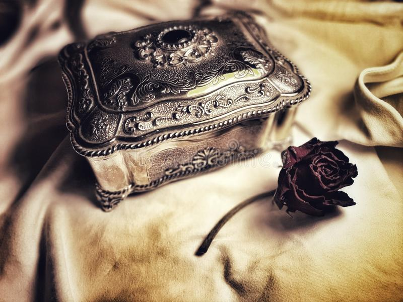 Jewelry box and rose royalty free stock photos