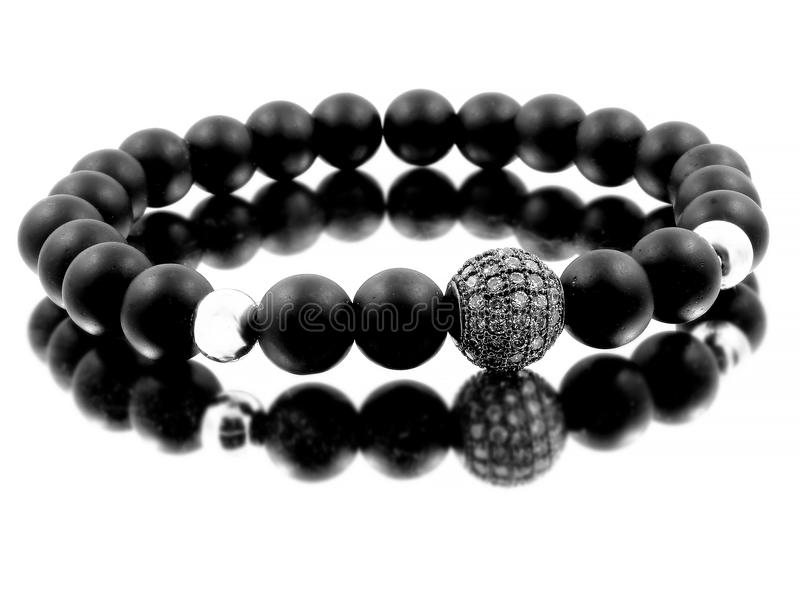 Jewelry Bracelet for Men - Lava Balls Bijouterie. One color background royalty free stock image