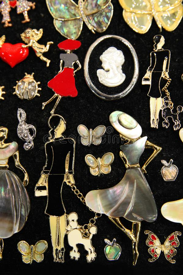 Jewelry brooches in the form of girls stock image