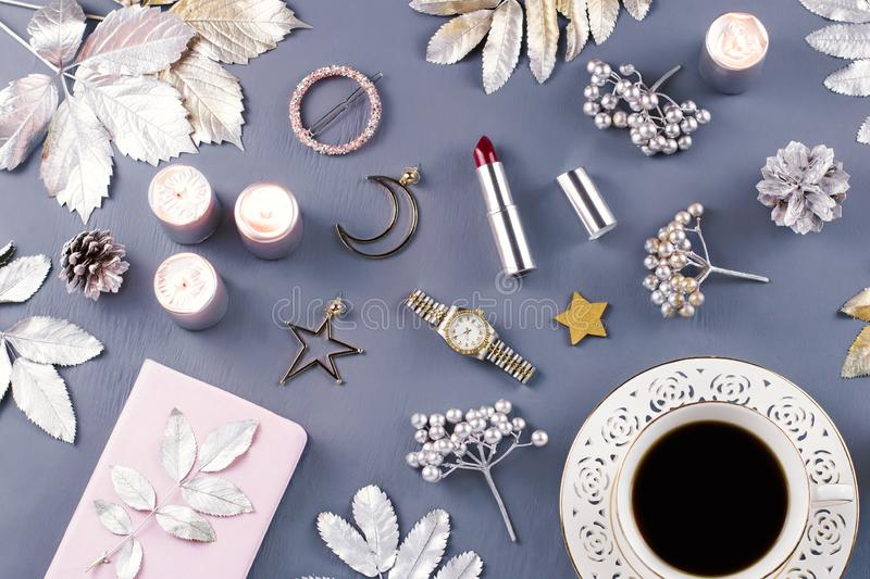 Jewelry and cosmetics with Christmas decorations and ornaments. Beauty blog, winter concept. Top view stock images