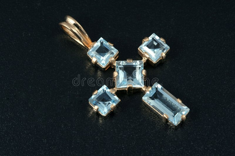 Jewelry cross. With blue sapphires royalty free stock image