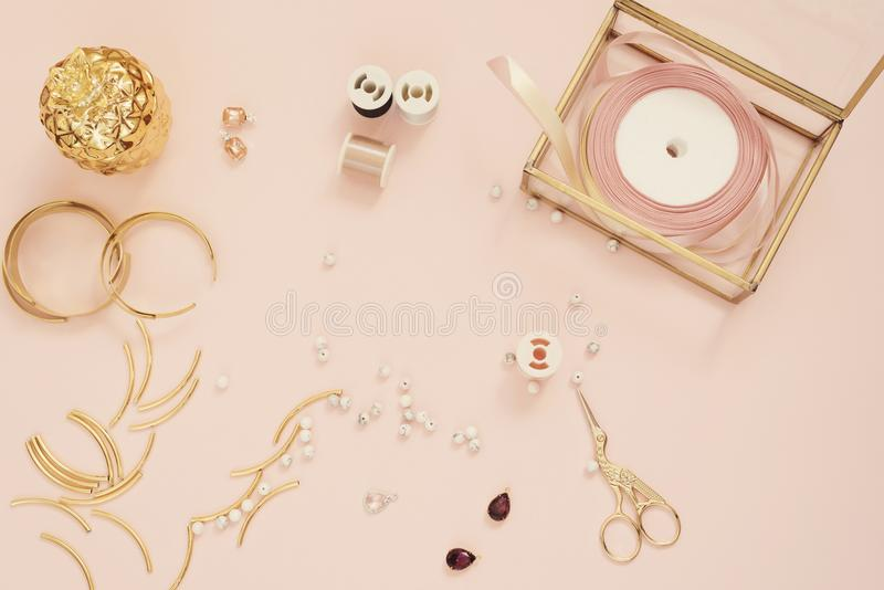Jewelry designer workplace. Handmade, craft concept. Materials for making jewelry ? golden scissors, ribbons, gold tubes, bracelet royalty free stock photography
