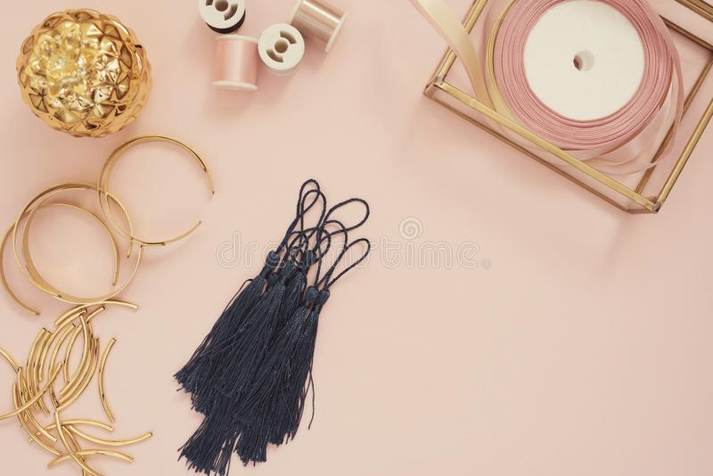 Jewelry designer workplace. Handmade, craft concept. Materials for making jewelry ? golden scissors, ribbons, gold tubes, bracelet stock image