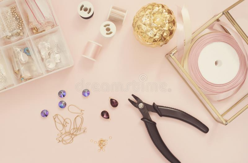 Jewelry designer workplace. Handmade, craft concept. Materials for making jewelry ? pliers, crystals? ear wires, ribbons. Freelanc royalty free stock images