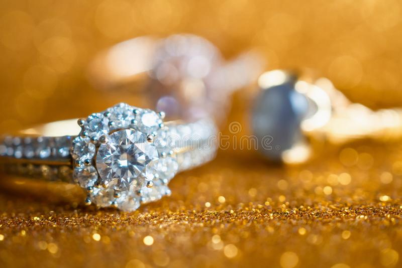 Jewelry diamond ring with abstract festive glitter Christmas holiday texture background. Blur with bokeh light royalty free stock images