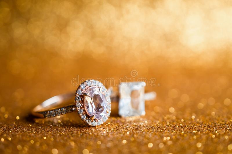 Jewelry diamond ring with abstract festive glitter Christmas holiday texture background. Blur with bokeh light royalty free stock photos