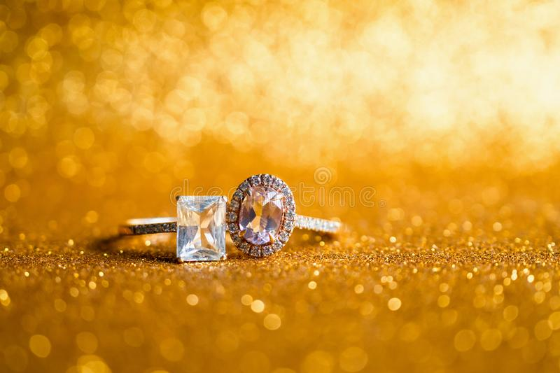 Jewelry diamond ring with abstract festive glitter Christmas holiday texture background. Blur with bokeh light stock photography