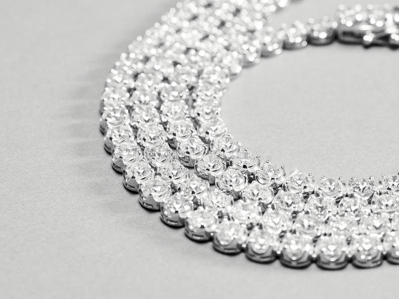 Jewelry. Diamond rings and necklaces show in luxury retail store window display showcase stock photos